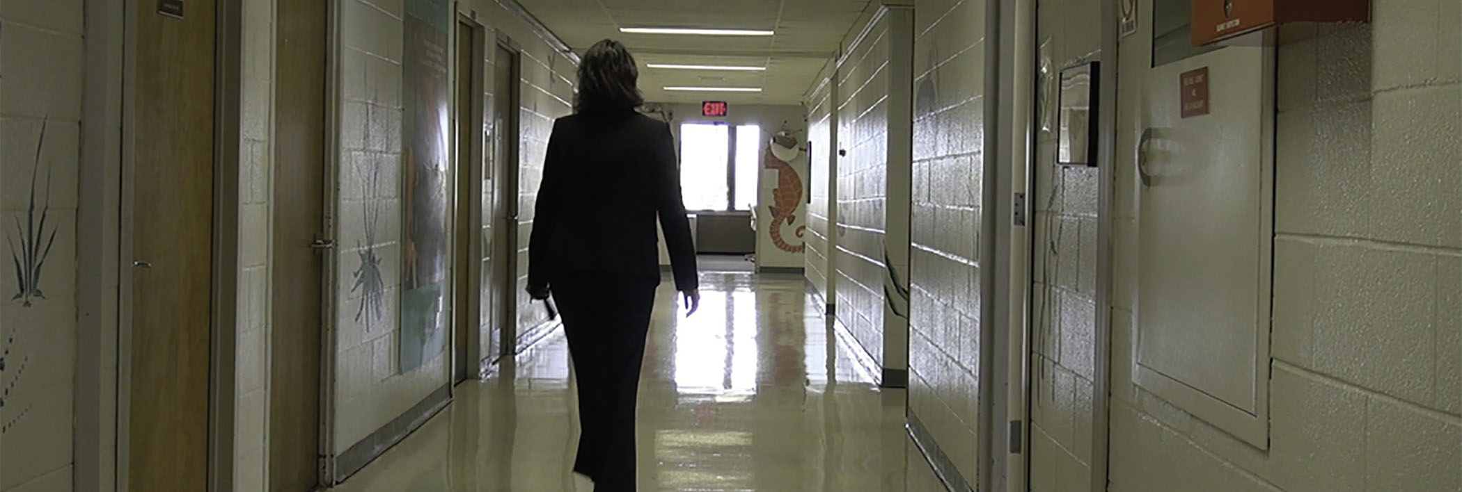 WIHD staff member walking down a hallway