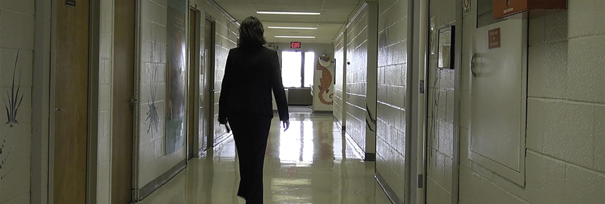 WIHD staff member walking down a hallway