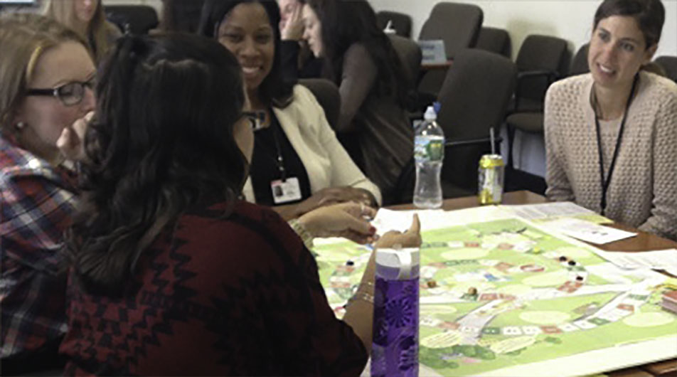 LEND trainees playing board game