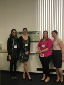 LEND trainees and faculty presenting a poster
